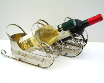 A Pair Of Vintage Wine Bottle Holders In Sleigh Form