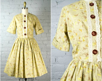 1950s day dress . vintage 50s dark yellow cotton dress . novelty horse print 1950s full skirt shirt waist dress . small
