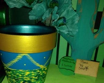 Teal and gold pot