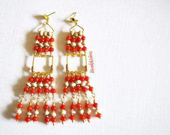 Dangling earrings with red beads and cream