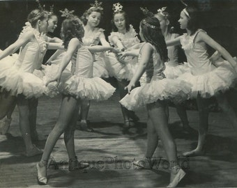 Beautiful Russian girls ballet dancers as snowflakes vintage photo Russia