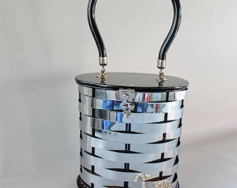 Dorset Rex Fifth Avenue Handbag. 1950s Basketweave Silver Tone Metal Bucket Style with Black Lucite Handle, Lid and Base.