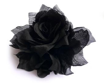 Black organza fabric flower brooch.
