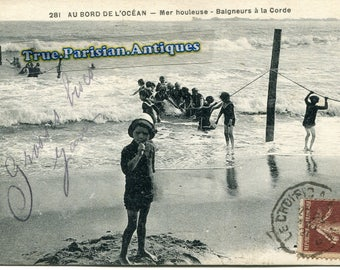 two postcards, childs on the beach 1920
