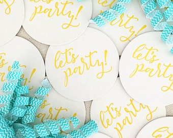 "Set of eight Yellow ""Let's Party!"" letterpress coasters"