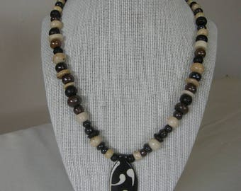 Batik Bone Bead Necklace with Leaf pendant.