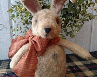 Beans, our little fuzzy bunny, with his orange homespun tie
