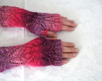 50 shades of pink hand knitted cables and lace fingerless gloves by Liz