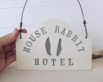 House Rabbit Hotel. Hand-Built Ceramic Wall Sign.  Rustic Folk Art For Rescued House Rabbits.  With Gray Letters and Ears.