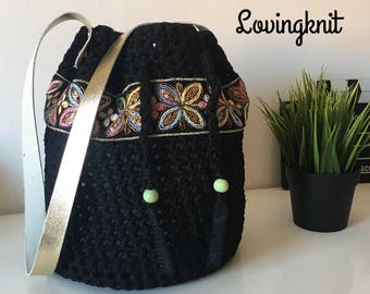 Women's black tulle handbag adorned with a beautiful pasamaneria
