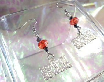 LOVE SEWING, dangling earrings with red and black beads.