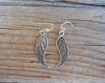 Angel wing earrings handmade in sterling silver
