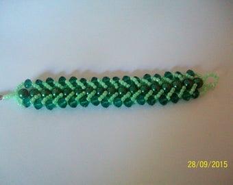 Green beadwoven bracelet has the needle