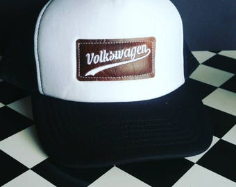 Volkswagen Trucker cap. This trucker cap has an embroidered logo on a leatherette patch. It's got a real retro vibe.  V.w. hat. V.W.clothing