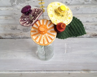 purple orange and yellow button flower bottle bouquet