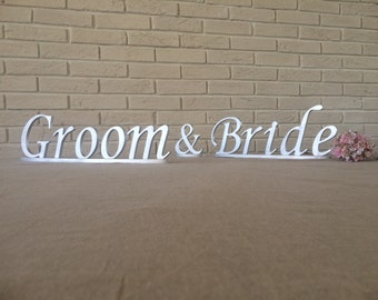 Bride & Groom silver wedding signs for wedding table decoration.  Groom and Bride sweetheart table wedding signs