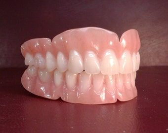 Upper and lower bleach dentures, wax tryin and new upper and lower impressions