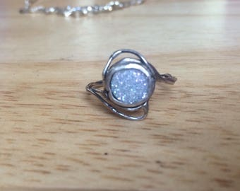 ring with white sparkling stone