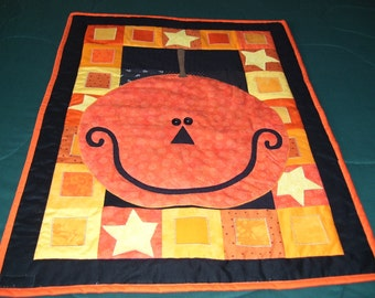 This quilt expresses the Happy Halloween sentiment that is felt this time of the year. It is machine quilted and appliqued. Wall quilt.