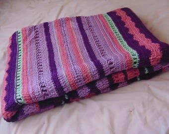 Handmade purple stripe afghan.