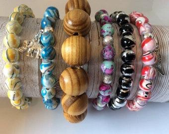 Set of 6 fun stretch bead and charm bracelets. Summer bracelets. summer colours. stretch braclets. charm bracelets. bracelet sets.