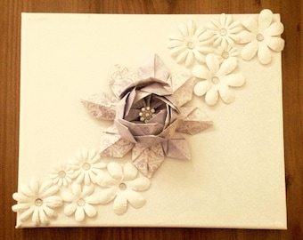 Origami lotus flower on a canvas