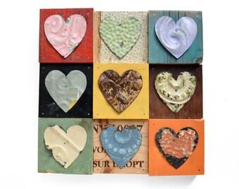 9 primitive hearts mixed media assemblage  by Elizabeth Rosen