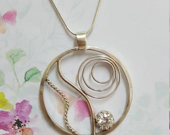 Sterling silver Pendant.  Beautiful free form with bling