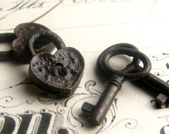 Rustic, weathered heart lock and oval jewelry box key charm sets from Bad Girl Castings, black pewter charms,  18mm (2 locks, 2 key charms)