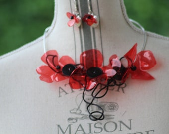Recycled red badoit Flower Adornment