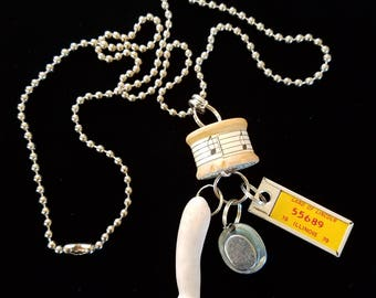 Repurposed Necklace with Doll parts etc.