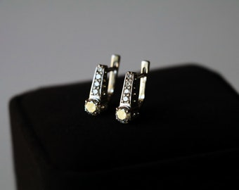 Silver earrings with bright white stones