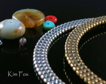 9 inch Beaded Bangle in Bronze and Silver Two sided oval shaped bangle with solid metal construction by Kim Fox
