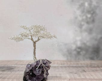A non tarnishing silver plated copper wire tree on a AAA grade Uruguayan amethyst base