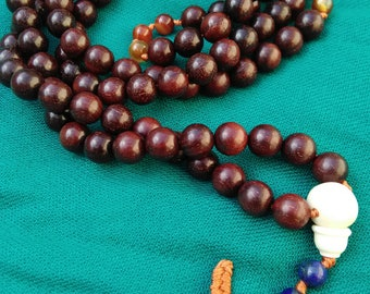 Custom Mala: Mantra style mala; Sandalwood with Carnelian spacers with Yak Bone guru bead and Lapis Lazuli