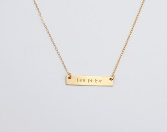 Gold quote bar necklace says let it be