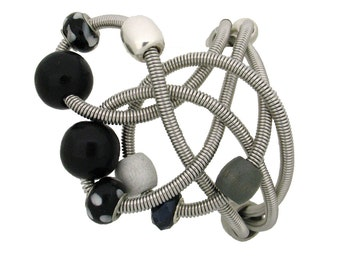 Malleable hand-turned anodized aluminum wire spring 3 rows bracelet adorned black beads, unique, stylish and ligth weight