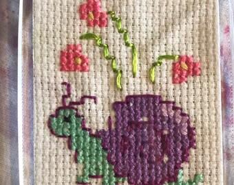 Snail cross stitch keyring
