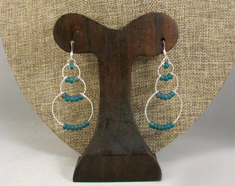 Silver wire bubble earrings with dark blue beads