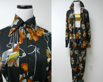 70s poly floral top and pants set . fits a medium to large