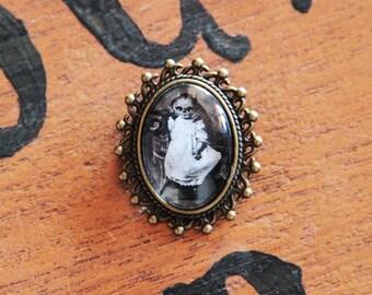 Baby Skull Cabochon brooch.