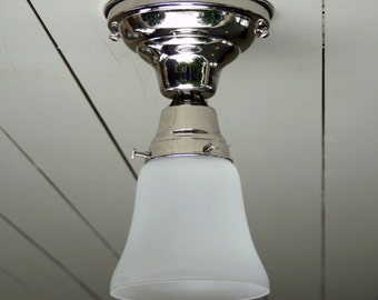 Vintage / Antique style, flush mount, polished nickel, single ceiling light.