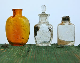 Vintage Italian pharmacy/perfume bottles with glass stopper and cork