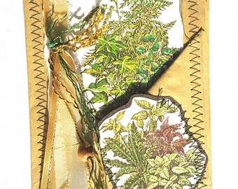 Handmade. Sewn envelope pocket. With plant images and sewn tassel.