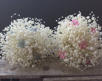 Pearl beaded bubble bouquet with pale blue flower brooches with dianantes at there centre. Bridesmaids bouquet.