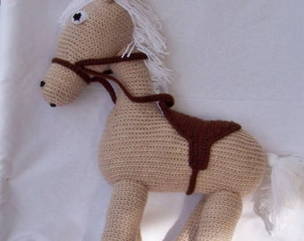 Pony is handmade, crocheted, beige and Brown