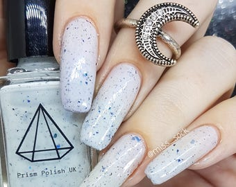 Icy-cool - a white polish with blue shimmer and blue flakies uk indie nail varnish
