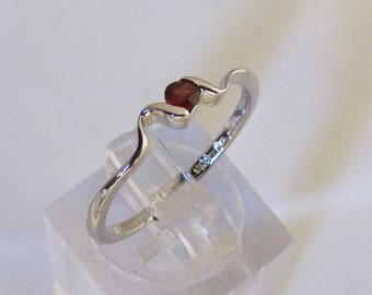 Mounted on silver knuckle ring and stone Garnet size 56