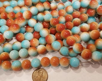Glass pearls. Turquoise in Terra cotta