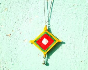 Necklace, THANON PHETCHABURI -- wood and cotton, orange / yellow with little bell by The Sausage